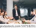 Business team having board meeting in modern office 59758201