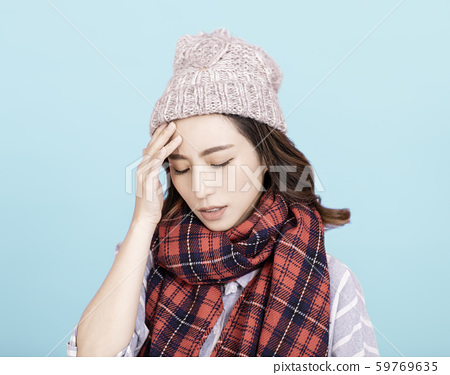 Sick young woman with headache 59769635
