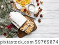 Christmas stollen on wooden background 59769874
