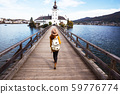 girl goes over the bridge to the castle ort 59776774