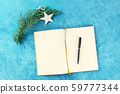 New Year's resolutions or bucket list concept, a flat lay top shot of a journal on a turquoise 59777344
