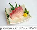 Sliced raw Hamachi sashimi on plate 59778520