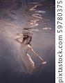 Girl in a dress swims underwater 59780375