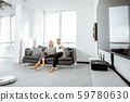 Couple watching television at home 59780630