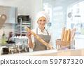 Baker woman selling bread 59787320