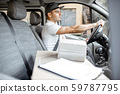 Driver delivering goods by vehicle 59787795