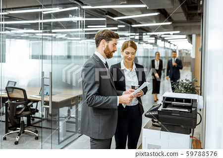 Business people near the copier in the hallway 59788576