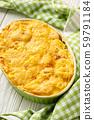 Potato, spinach and feta cheese casserole. 59791184