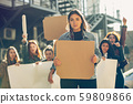 Young people protesting of women rights and equality on the street 59809866