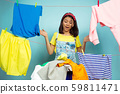 Funny and beautiful housewife doing housework on blue background 59811471