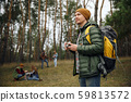 Group of friends on a camping or hiking trip in autumn day 59813572