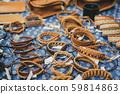 Leather bracelets at market 59814863
