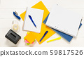 Notepad with pens and stickers. Notebook, pen, books, and pencil holder in the shape of shoe on the white wooden table 59817526