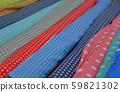 Multicolored fabrics in rolls 59821302