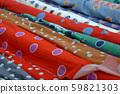 Multicolored fabrics in rolls 59821303