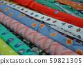 Multicolored fabrics in rolls 59821305