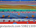 Multicolored fabrics in rolls 59821309