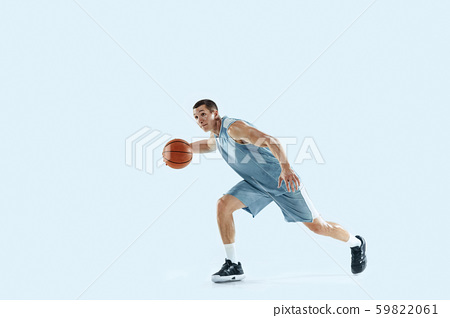 Young caucasian basketball player against white studio background 59822061