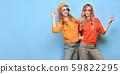 Two Fashion fun woman dance, Trendy orange outfit 59822295