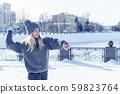 woman prepared to throw a snowball 59823764