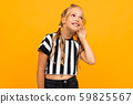 naughty girl on a yellow background eavesdrops 59825567