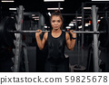 Beautiful weightlifter practicing in gym 59825678