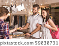 Young adult woman and man buy clothes in trendy boutique 59838731