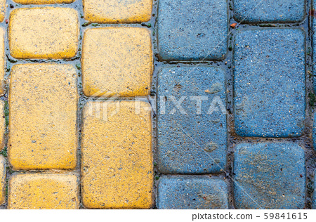 yellow and blue cobbles of pavement texture 59841615