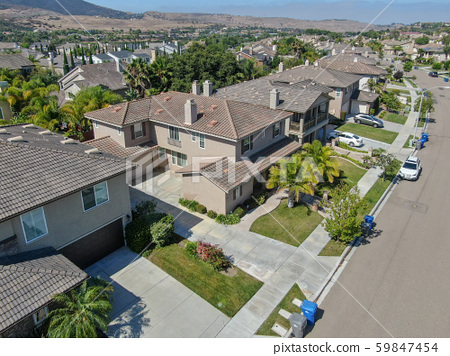 Suburban neighborhood street with big villas 59847454