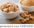 White bowl plates of natural brown sugar cubes and 59850685