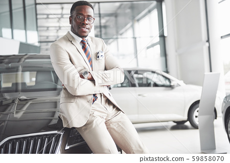 The young attractive black businessman buys a new car, dreams come true 59858070
