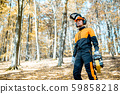 Professional lumberjack in the forest 59858218