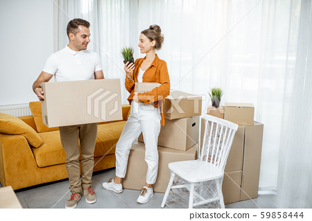 Young couple moving into a new house 59858444