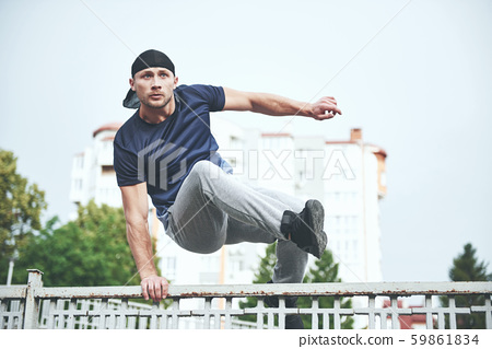Young sports man doing parkour in the city. 59861834