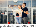 Beautiful couple standing in a airport 59870993