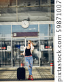 Beautiful girl standing in a airport 59871007