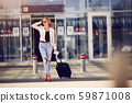 Beautiful girl standing in a airport 59871008