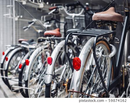 Bicycles in bike parking transportation in Japan 59874162