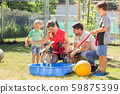 Family playing with dog from animal shelter 59875399