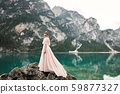 Beauty woman, bride with perfect white dress background mountains 59877327