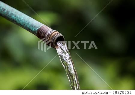 Garden water hose close up 59879553