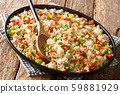 Asian rice with seasonal vegetables and bacon 59881929