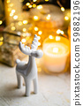 Little white ceramic Christmas deer figurine with yellow holiday lights 59882196