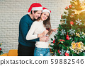 Christmas celebration of couples. 59882546