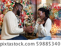 Loving man making proposal to his excited girlfriend, giving engagement ring 59885340