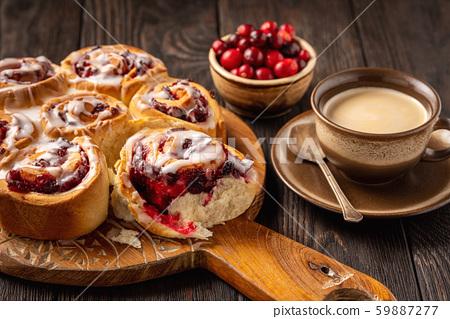 Homemade cranberry and orange swirl buns wuth glaze.  59887277