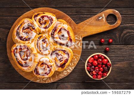 Homemade cranberry and orange swirl buns wuth glaze.  59887279