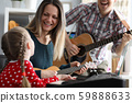 Happy family plays musical instruments on background 59888633