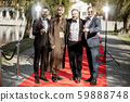 Movie actors on the red carpet outdoors 59888748