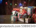 pile of wrapped gift boxes, holiday image 59890349